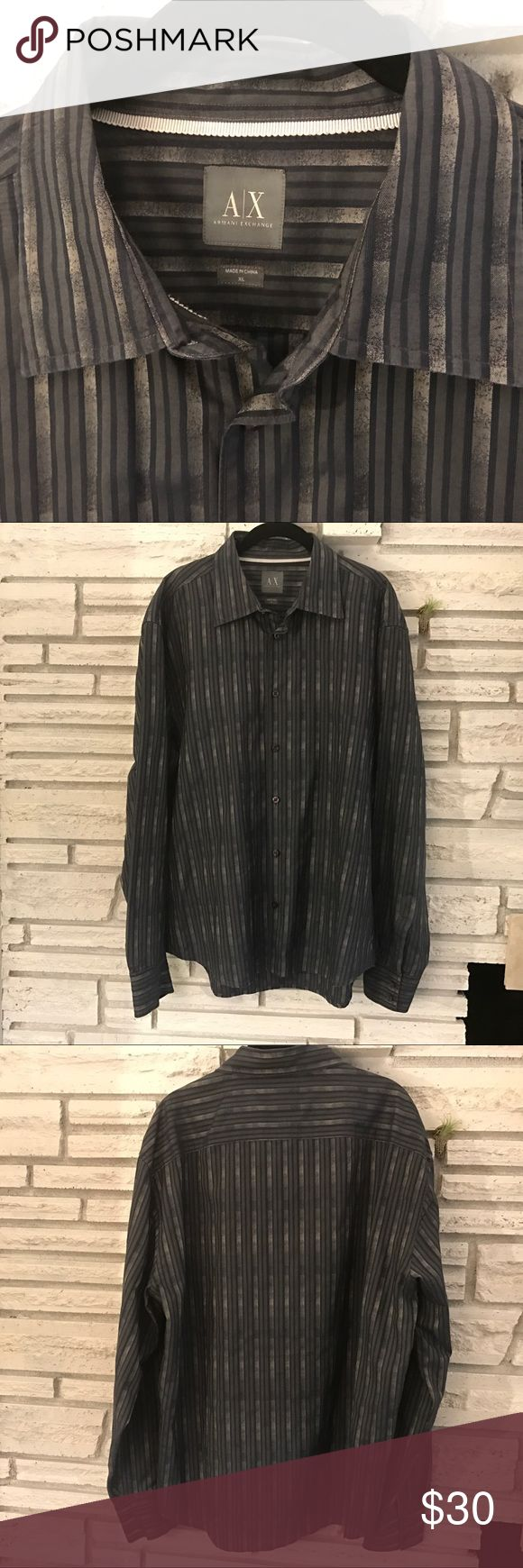 Got a stylish XL guy in your life? This shirt is in excellent Condition. I bought it for my Italian husband but he's inching into the XXL range so this was a little too small.  Looked super attractive on him though ;) I love the silvery metallic detail and cut. Armani Exchange Shirts Dress Shirts
