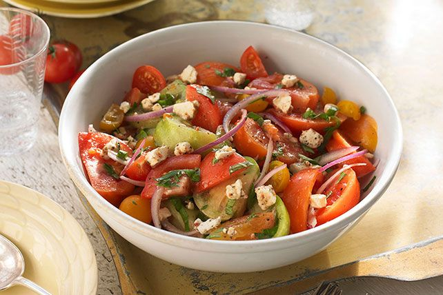 One taste of this salad with juicy tomatoes with tangy cheese and fresh herbs, and you'll never want summer to end. Unadorned, flat-out fab.