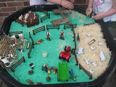 Farm Sensory table. Wood shavings for the sheep, brown playdoh for the pigs, straw for the cows.