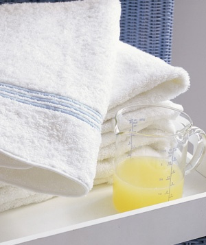Use 1/4 to 1/2 cup of lemon juice to the wash cycle to brighten up faded whites.