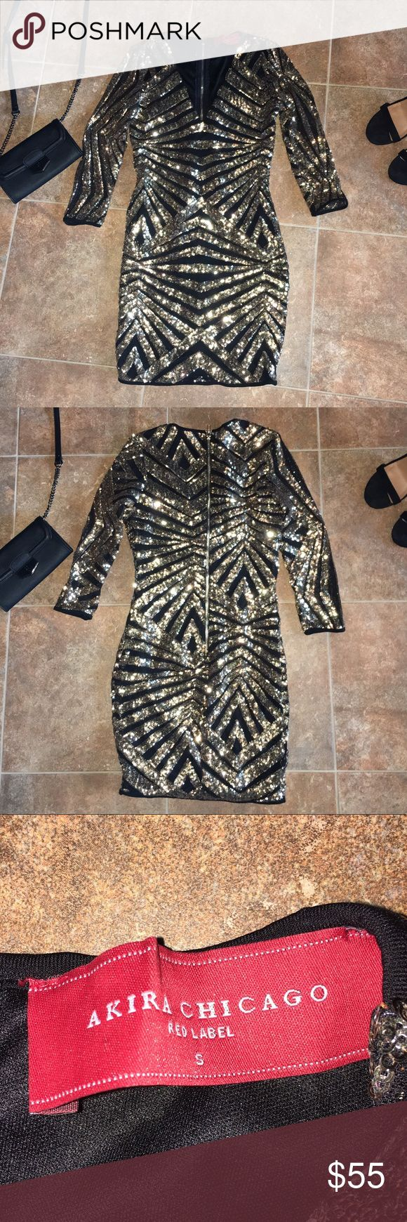 Akira Black & Gold Sparkle Pattern Night Out Dress Worn once for a short amount of time! Akira Chicago black and gold sparkle pattern tight v-neck night out dress. Looks absolutely gorgeous on without being too promiscuous. Size Small! In excellent condition! AKIRA Dresses Mini