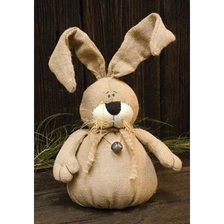 Burlap Bunny is stuffed and has bendable ears for easy posing. It has raffia and bell accents, and a weighted bottom. Bunny measures 15 tall.