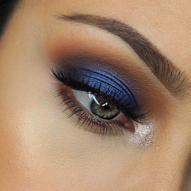 Navy blue eye with glitter inner corner.