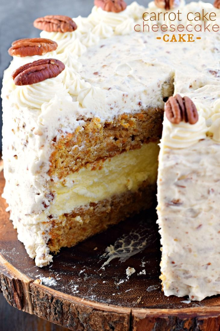 This Carrot Cake Cheesecake Cake is a showstopper! Layers of homemade carrot cake, a cheesecake center and it's all topped with a delicious cream cheese frosting!
