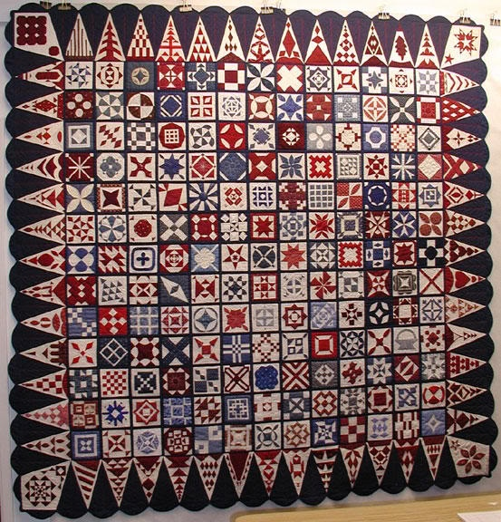 Red white and blue Dear Jane. I like the dark triangles in the border.
