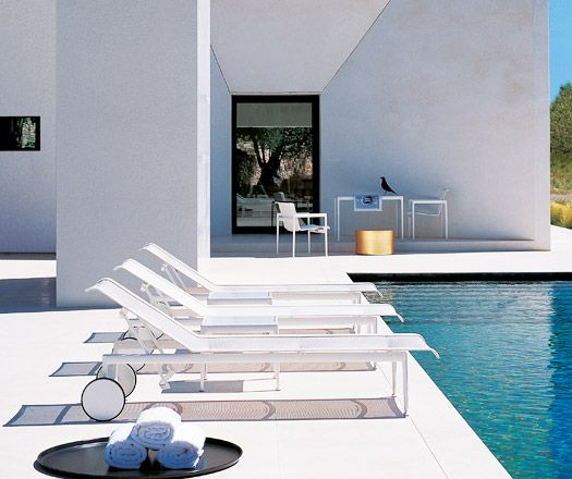 B&B Italia modern outdoor furniture at modern concrete home and pool