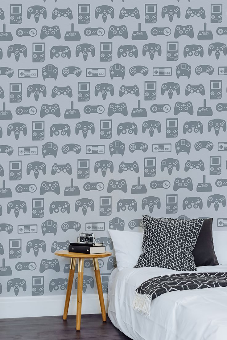 Designing your kid's bedroom? Take a look at this playful wallpaper design that features fun illustrations of gamepads over the years. The grey colour palette makes it both versatile and timeless. Choose to keep colours muted or contrast the wallpaper with bright accessories!
