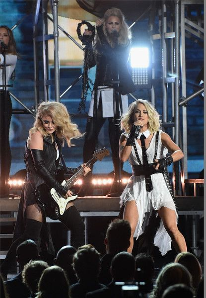 Carrie Underwood Photos Photos - Carrie Underwood performs with Lindsay Ell (left) of her all female band during the 50th annual CMA Awards at the Bridgestone Arena on November 2, 2016 in Nashville, Tennessee. - The 50th Annual CMA Awards - Show