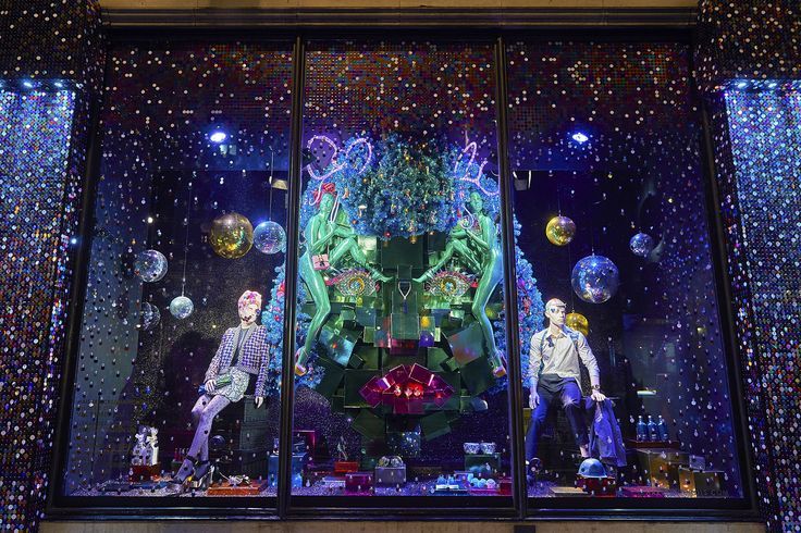 "Harvey Nichols and Fortnum & Mason have revealed their Christmas windows, with both stores opting for festive-inspired scenes bursting with colour, sparkles and glitter. Window designers at Harvey Nichols, left, used at least a million flakes of glitter, more than 300,000 sequins, 15,000 gift boxes, 540 baubles and 620 mirror balls to create the scenes, under a loose theme of ""disco-glam"". The look is inspired by Studio 54, the partywear trend of the season."