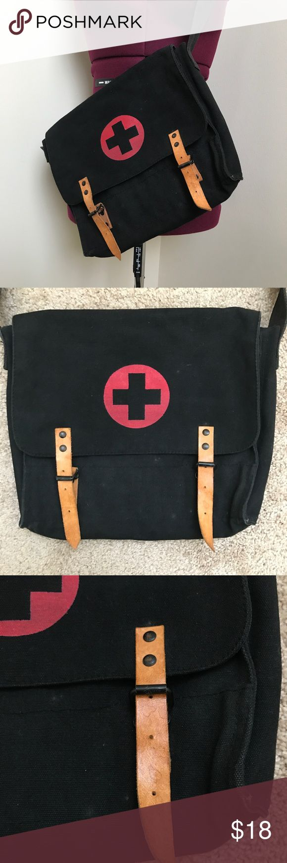 Vintage Military Medic bag Personally purchased this bag at an Army surplus store about 15 years ago. Used as an everyday bag and to keep books in for school. Some wear but plenty of life left! Bags