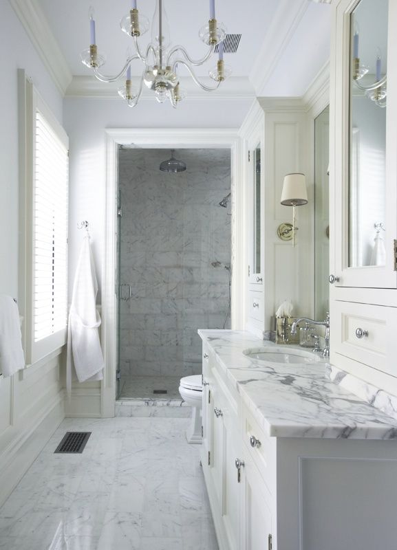 White Marble + gorgeous architectural details =perfection in this beautiful bathroom! #MyMetrie