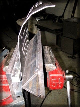 Press Brake by Number9 -- Homemade press brake constructed from angle iron, steel plate, and square rods mounted on a bench vise. http://www.homemadetools.net/homemade-press-brake-24