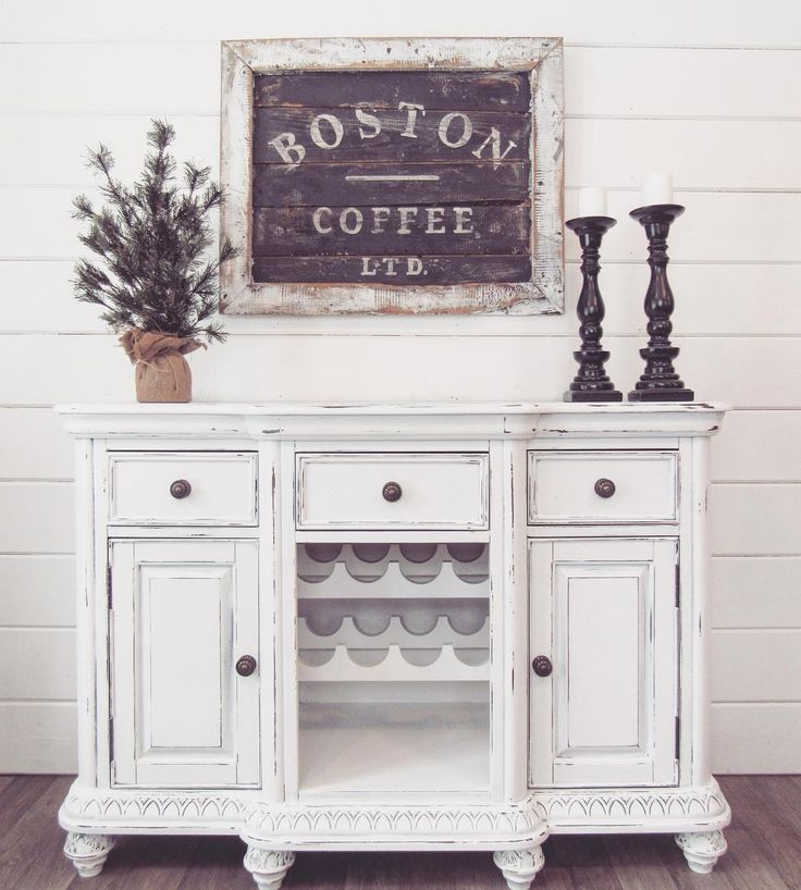 """Just listed! This beautiful server is painted white and is lightly distressed. There are three dovetailed drawers and two cabinets for storage. There is a built in wine rack in the middle. It measures 50""""w x 18""""d x 34.5""""h. shackteauinteriors.com"""