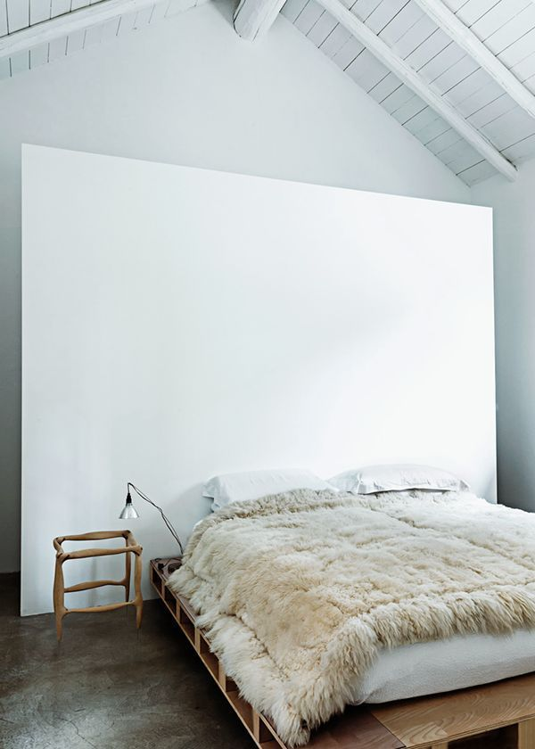 A great idea to conceal your wardrobe area by placing it behind the bed/wall area