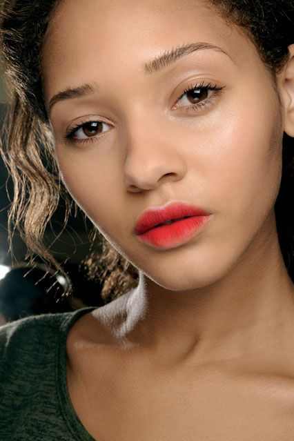 ERDEM - Andrew Gallimore applied MAC Scarlet Ibis Lipstick over the lips, keeping the edges blurred and feathered. A little MAC PRO Basic Red Pigment at the centre accentuated the ombre effect.