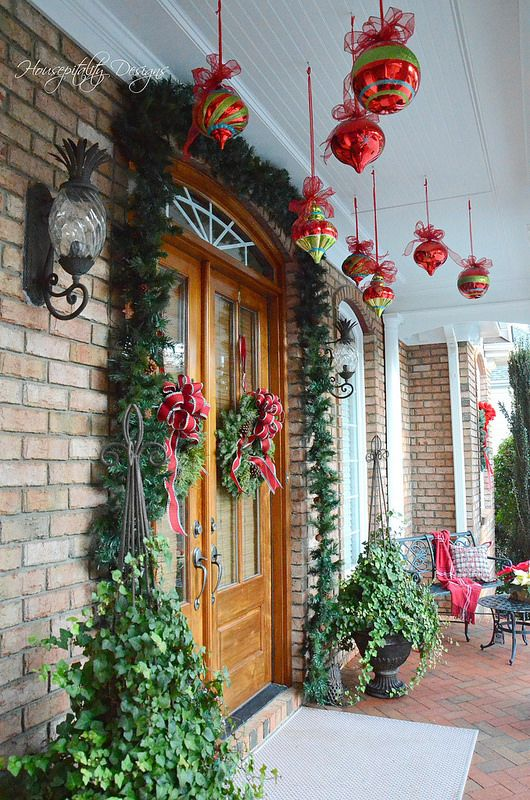 Christmas Porch-Housepitality Designs Love the hanging ornaments!