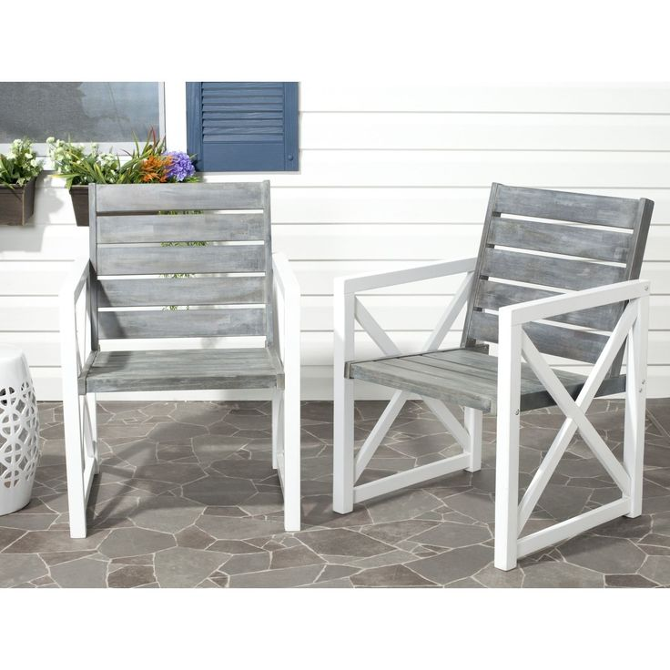 Crafted with dark grey acacia wood and galvanized steel, the Irina arm chair set offers sleek, modern style--and a warm welcome to any outdoor room.
