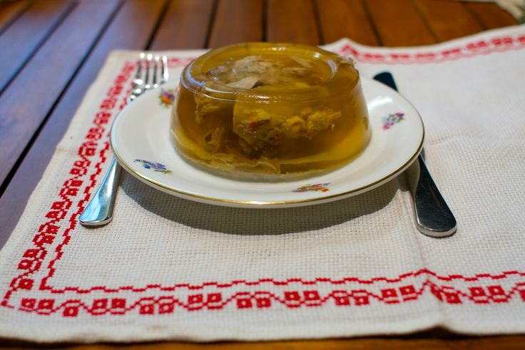 Hungarian Pork Meat in Aspic (Kocsonya). (Suggestion: Place halved or slice hard boiled egg among the pieces of meat - best to use a large rectangular glass pan - before pouring on the unsolidified aspic.)
