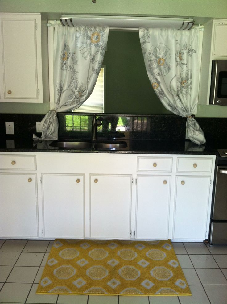 Black counter tops with white cabinets, pop of yellow, kitchen decor