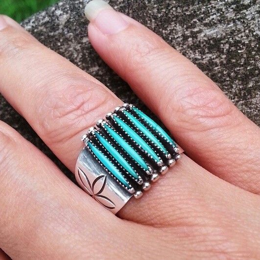 Absolutely stunning vintage turquoise petit point ring with flower stamping on each side all set in sterling silver.   Maker's Mark Paloma Zuni.  Size 7.5 $125