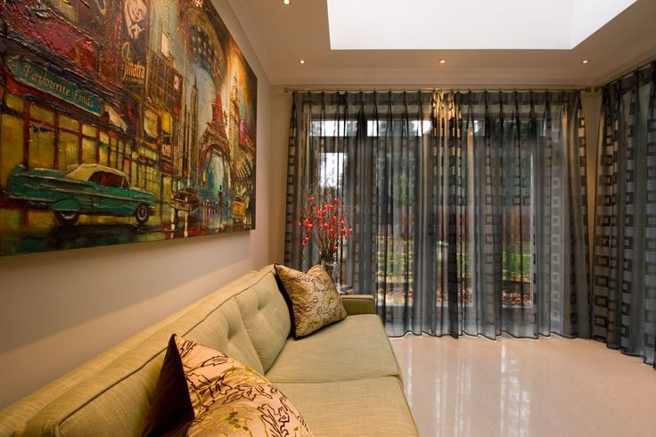 A family room in a contemporary executive new build, Ascot. Inspiration for the scheme came from the colours and reflections in the amazing picture.