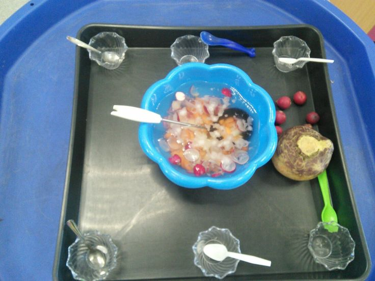 Making soup activity in the water tray linked to the enormous turnip