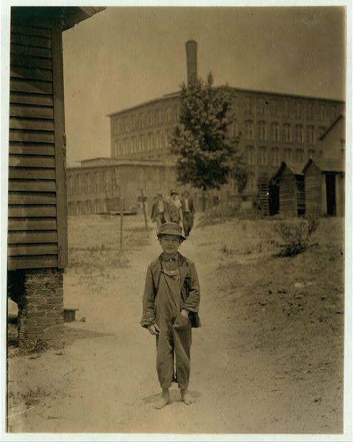 Eddie Norton sweeping in Saxon Mill (See label Location: [Spartanburg, South  Carolina].