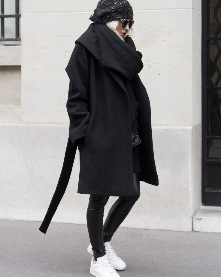 Figtny shows us how to wear all black in this gorgeous wool wrap around coat and edgy leather leggings. Coat/Leggings: Net A Porter, Sneakers: Mango.