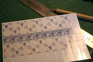 """The kitchen tiles were found on the internet in a free project and then printed onto glossy photo paper. """"Grouted"""" lines were scored."""