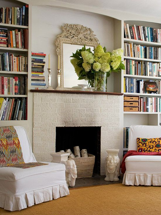 Built-in bookcases are a great way to create a symetrical look around a fireplace. The space is not wasted and adds visual interest. I would love to have this in my dream home den or library.