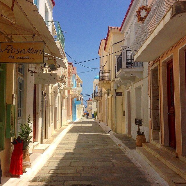 The elegant alley of Chora , at Andros island (Άνδρος). Explore the wonderful historical buildings and the statue of the Unknown Sailor at the main marble paved square !