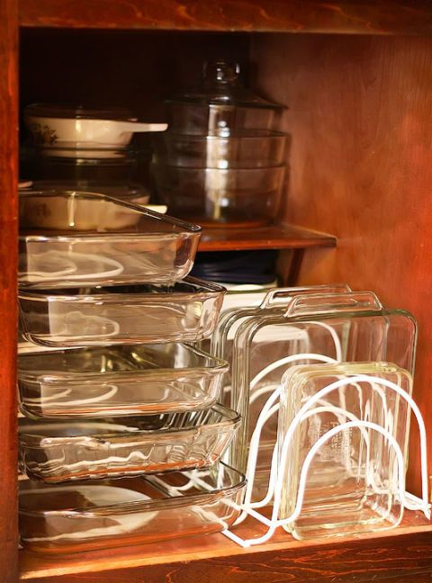 Instead of stacking heavy glass dishes on top of each other, stack them vertically or horizontally with the help of narrow wire organisers usually found in offices. See more at Kevin & Amanda »