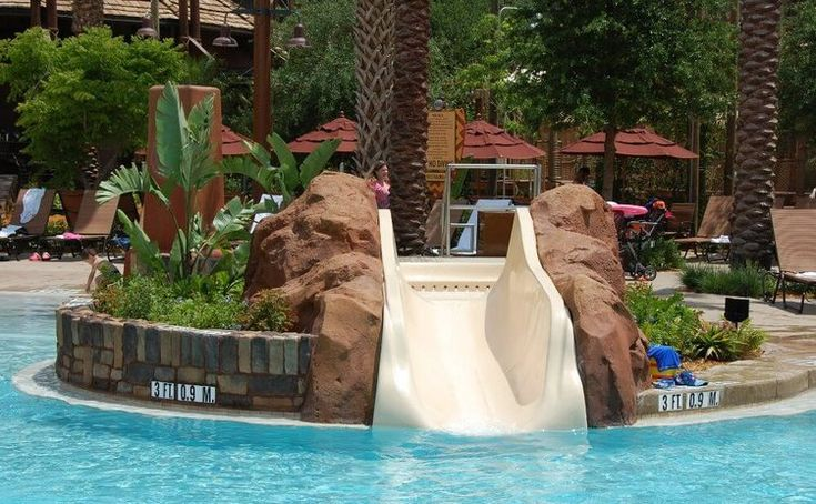 Children's slide IN THE zero-depth entry pool at the SAMAWATI SPRINGS POOL COMPLEX AT DISNEY'S ANIMAL KINGDOM LODGE - ZIDANI VILLAGE -ONE OF THE BEST SPLASH ZONES OF THE DISNEY WORLD HOTELS, DELUXE RESORT CATEGORY.