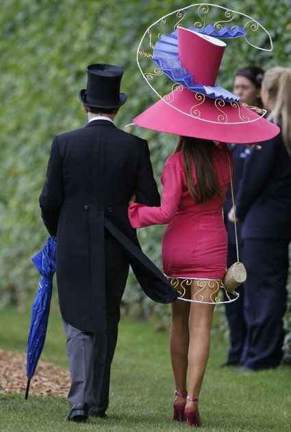 A race going couple take a stroll in the Royal Enclosure on the third day, traditionally known as Ladies Day, of the Royal Ascot horse race meeting at Ascot, England, Thursday, June, 16, 2011. I gotta say...I actually like it. LOL The mind wobbles