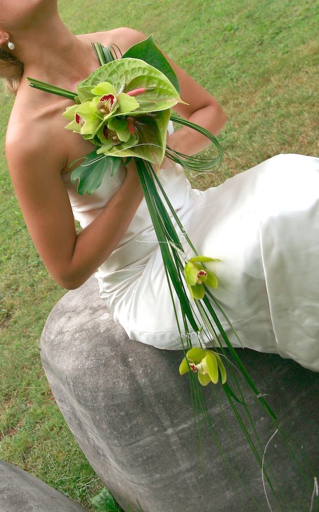 This would be fantastic for a beach wedding. Bridal bouquet of green Anthuriums & Cymbidium Orchids - designed by Dominique Houle, Canada; Loved by Jemini Flowers, Oxford (www.jemini.co.uk)