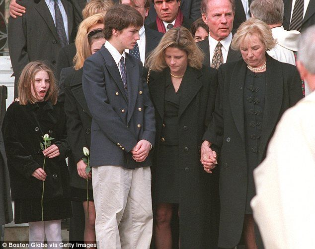 Poignant: Michael aged 14 with other members of his family at his father's funeral in January 1998