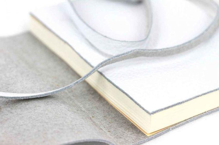 Ce sublimecarnet de voyage vierge de couleur blancheest un magnifique livre aux page blanches
