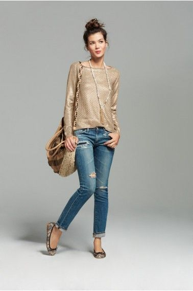 Use a metallic sweater to jazz up simple jeans and flats.