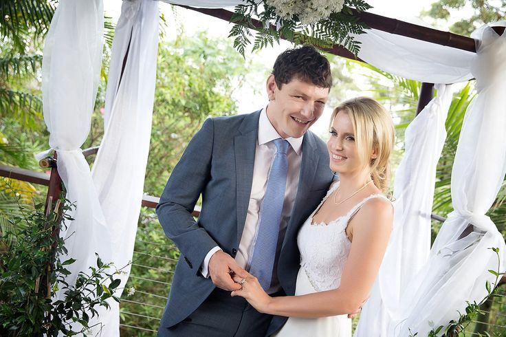 Just married! Standing under our beautiful home made arch - bamboo held together with cable ties propped up in jasmine pot-plants (Bunnings), draped in white cloth (spotlight $20) and decorated with a bouquet of flowers (Woolworths flowers - arranged by my brother!).