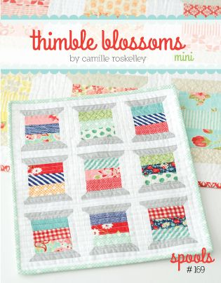 "Finished Quilt: 14"" x 16"" 3.5"" x 4.5"" block Fabric Required 14 charm squares for spool centers 1/4 yard fabric for spool ends 1/3 yard background fabric 1 fat quarter binding fabric 1 fat quarter back"