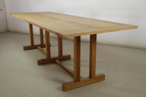 Combining contemporary style with classic design, this solid Oak table is a stand-out piece. The bright and slim, smooth oak surface is juxtaposed against dark and distinctive I-beam legs, giving the piece a unique aesthetic. This striking design has a beautiful natural hard wax oil finish, which not only enhances the wood's character but also provides a long-lasting protective seal. This versatile item invites use as a grand dining table, perfect for entertaining. Alternatively, with such…
