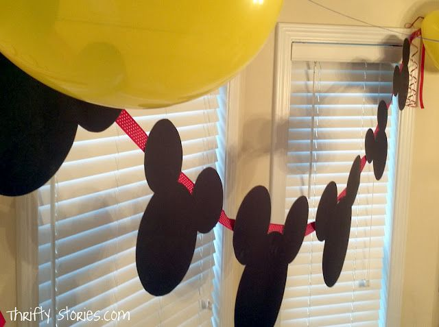 Mickey Mouse party banner.  Made with black poster board, ribbon and hot glue.  Super-duper easy.