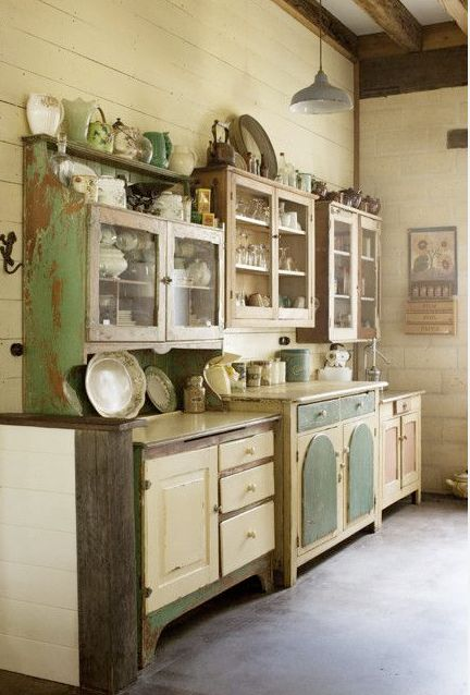 French Country Home, French Living - Sharon Santoni  This is similar to what I did in my dining room, combining hutches to fill up an entire wall giving it a built-in feel
