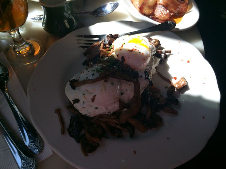 Potato bread, ricotta cheese, field mushrooms and poached eggs. Side of maple glazed bacon.