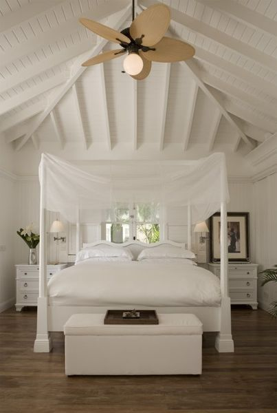 lay mosquito netting on top of a 4 post bed frame for a more romantic feel