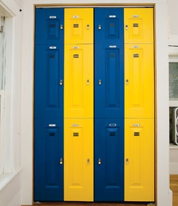 Paint closet doors and add metal label holders, wire rope clamps and small pad locks to make them appear as lockers.  Wish I'd seen this when my son was younger!