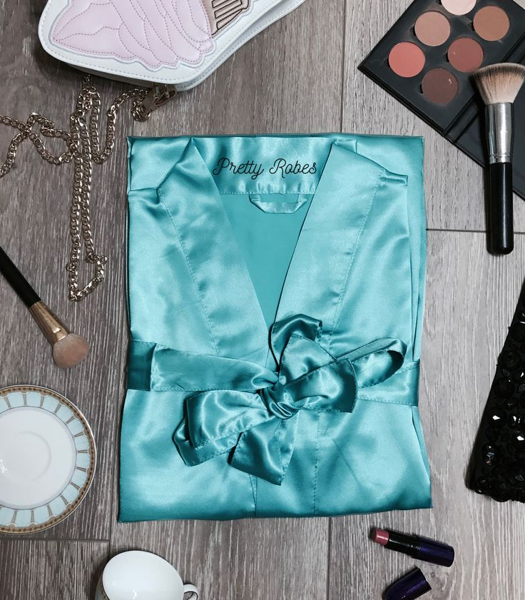 Silky chic and beautifully stitched satin robes at an affordable price point. Perfect as a Bridesmaid Robe or favor and available to be customized or shipped as is. - Surplice wrap satin V-neckline -