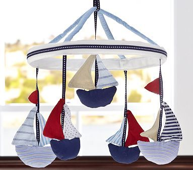 Landon's nursery mobile... LOVE IT! In case you are interested, the mobile and mobile arm are sold separately! Making this a pricey but all too adorable mobile! Sailboat Mobile #pbkids