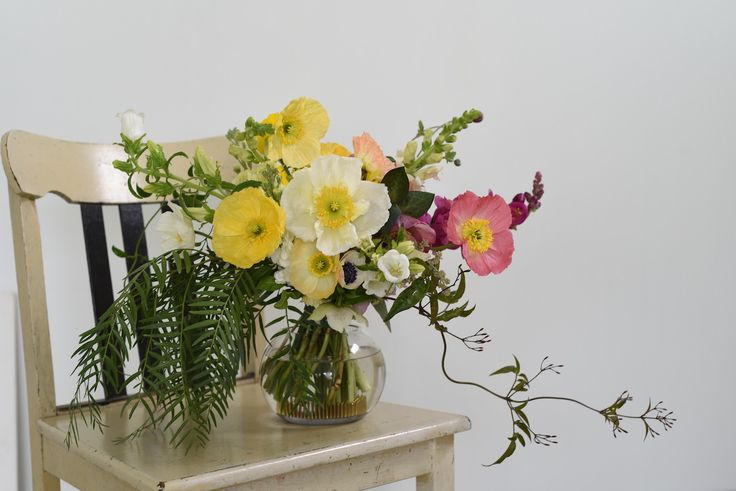 colourful winter bridal bouquet with poppies, snapdragon, jonquils, daffodils, anemones, ranunculi, campanula, peppertree leaves and jasmine. 30.July