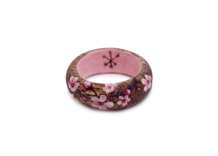 Unleash your inner huntress with a hand painted cherry blossoms wooden ring by Huntress & Hunter. $27.11